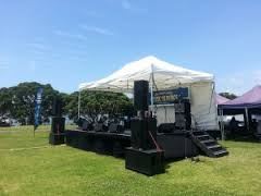 covered stage hire - Music in Parks Auckland: our medium 6 by 4m Stage, Marquee, and Soundsystem.