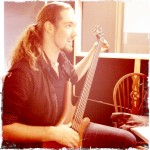 Adam Recording Bass in the Recording studio - try one of our recording package deals